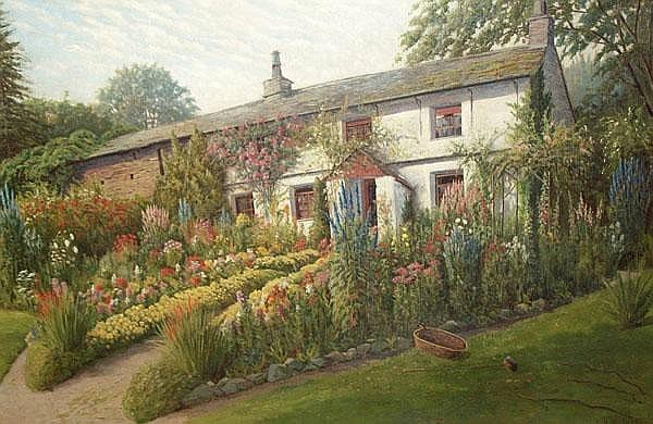White cottage surrounded by flowers and shrubbery