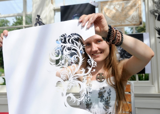 Lois Cordelia demonstrates her paper cut art